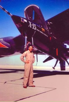 Test pilot Albert Scott Crossfield with X-15 56-6670 attached to the right wing pylon of NB-52A 52-003 at Edwards Air force Base. (North American Aviation Inc.)