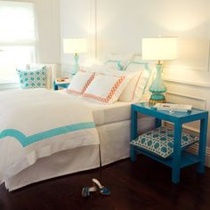 I'm obsessed with this room! Chic bedroom with full wall wainscoting framing queen bed filled with turquoise bedding, Haute Home Roma Applique Bedding in Milk Stone Blue with small lattice embroidered shams in orange. Contemporary Bedroom, My New Room, Apartment Living, Home Accents, Decoration, My Dream Home, Room Inspiration, Sweet Home, New Homes