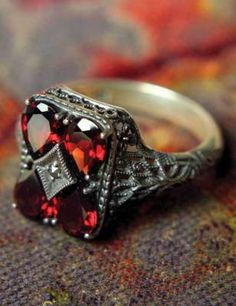 Cabernet Crystal Filigree Ring -        Once an Edwardian engagement ring, this gorgeous art deco design is rendered in garnets and Swarovski crystal. 5-9.