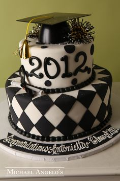 Black & White #3Graduation  This fondant creation is unique because of the bottom layer design. It is decorated with a square diamond technique and really makes this cake stand out from all the rest.