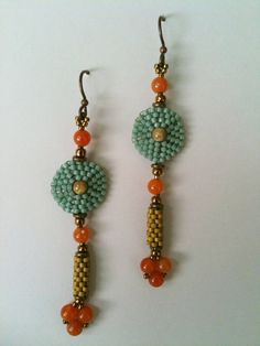 Soft Aqua, Orange & Olive Circle & Tube Earrings by Jeka Lambert.  Seed bead woven.  Glass beads, red aventurine, seed beads.