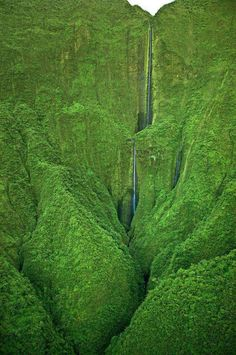 Honokohau Falls, the tallest waterfall on Maui, Hawaii. The only way to see it is by doing a helicopter tour over the remote region.