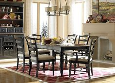For a vision of classic style. Our Westbury collection hosts French provincial silhouettes. Antique brass knobs enhance the sophisticated look of the rub–through, multi–step finish. A reverse–diamond cherry inlay on the tables adds appeal
