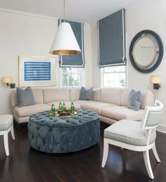 Sophisticated corner conversation space | Ty Larkins  -- we need an ottoman/coffee table for the living room