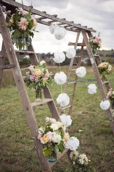 wooden ladders with floral bouquets for wedding backdrop