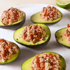 Canned tuna for sushi-style spicy tuna?! YES. Trust us, it's amazing in these stuffed avocados. #easyrecipe #sushi #sriracha #lunch #avocado