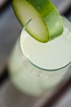 Valley & Co.'s Springtime Lemonade - Dig the stemless champagne glass garnished with a thick cucumber slice!