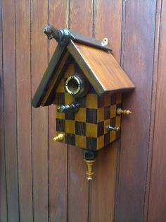 chess bird house, made of an antique inlay wood chessboard and original chess pieces each from a different set.