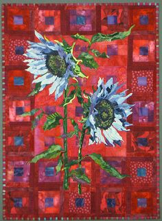 Another beautiful quilt by Terry Kramzar. I love her simple, but striking backgrounds and the blue sunflowers are stunning.