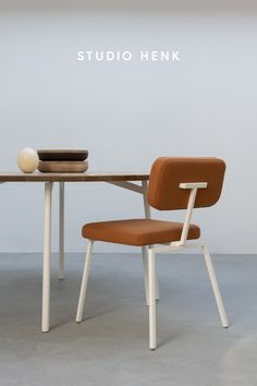 The Ode Chairs from Studio HENK are styled here with a burnt orange upholstery to create a bright and vibrant dining room interior. This design chair can be customised with over 400 different fabrics to create your own unique dining room setting. Shop the Ode Chair online now at Studio HENK. #studiohenk #diningchair #chair #diningtable #table #quadpod #oak #furniture #interiorinspiration #slowliving #vibrantinterior #orange #burntorange #orangefurniture #oakfurniture #interiors
