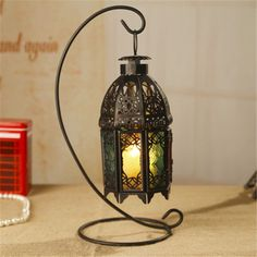 Imagine you are in a Moroccan Kasbah with this stunning iron and glass candle or tea light lantern. Use inside on winter nights or outside on warm evenings.