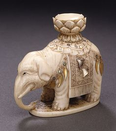 Soichi (Japan)  Caparisoned Elephant, late 19th-early 20th century  Netsuke, Ivory with light staining, sumi, and inlays including mother-of-pearl,