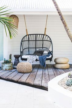 Bohemian inspired outdoor space with a hanging chair