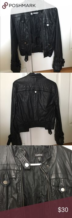 Bebe Leather Moto Jacket Cute leather with gun metal hardware. Buckles at wrist. Perfect condition worn once. bebe Jackets & Coats