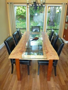 Dining room table Chris made with a glass insert. Raw edge, made from local Vancouver Island wood.