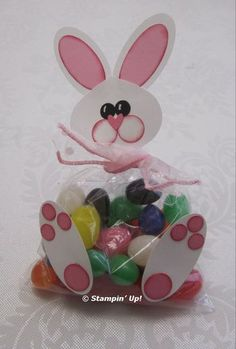"""Punch art jelly belly bunny. Head - Ornament punch; use ribbon to cover up the bottom of this piece Face - 1/2"""" Circle cheeks Nose - small heart Eyes - Owl punch, with white gel pen for accents Ears - white part; 1 3/4"""" X 7/8"""" Oval punch and the small oval punch (retired) for pink part Feet - Owl punch for smaller circles, 1/2"""" circle punch for the bottom, larger circle"""