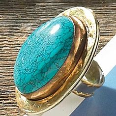 GOLD METAL WHITE RING WITH TURQUOISE  _  A large faux turquoise stone adjustable ring to go with any outfit! one size fits most.