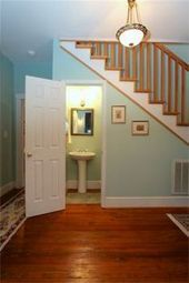 An adorable little powder room is tucked under the stairs. - 300 Mill Avenue, Jacksonville, NC 28540 US Jacksonville Home for Sale - Lori Smith New Homes Powder Room Small, Bathrooms Remodel, Office Room Decor, Bathroom Under Stairs, Model Homes, Staircase Storage, New Homes, Bungalow House Design, Stairs