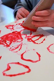 Painting with a toilet paper tube.  Definitely want to try this with D next year for Valentine's. #paint #hearts #valentine #toddler #kids #art