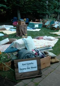 Scattered cushions, pillows and blankets for outdoor cinema