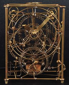 Brass Electric Kinetic Clock