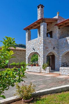 Enjoy the green #surrounding, full of trees and flowers, of a #traditional stone-built Villa next to the Cretan #nature! #crete #villa #travel #holidays #view #garden #grass #flowers #trees #stone #TheHotelgr