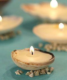 For a beach wedding, with floating candles and flower, flower petals, etc. Seashell candles DIY from Martha Stewart. Seashell Candles, Diy Candles, Candle Wax, Seashell Centerpieces, Diwali Candles, Sand Candles, Modern Candles, Homemade Candles, Candle Shop