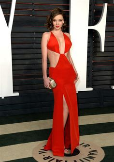 Miranda Kerr looked ab-tastic in a red KaufmanFranco dress with a plunging neckline, midriff cutouts and a thigh-high slit during the Vanity Fair Oscar Party in Beverly Hills, California, on Feb. 28, 2016.