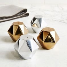 Modernize your seasoning. In graphic shapes, our Geo Salt + Pepper Shakers are like miniature statues for your table.