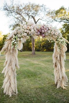 Look at this arch! Pampas grass, protea, garden roses, canterbury bells.... by Bows + Arrows