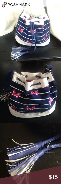 Navy And Hot Pink Minnie Mouse Bucket Purse Disney Parks Authentic Original used in good condition one of the tassels is a little frayed from wear and tear Disney Bags
