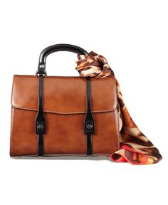 A structured designer satchel will take your look from pretty to polished.