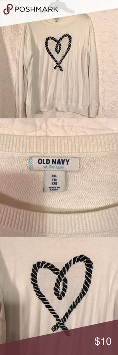 Old Navy cream and navy blue sweater This sweater has only been worn once. It is cream colored with a navy blue heart on the front. Old Navy Sweaters Crew & Scoop Necks