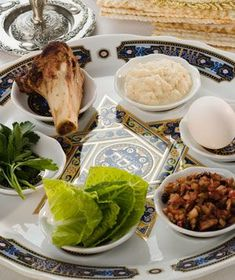 Table set for Seder with traditional food and dishware