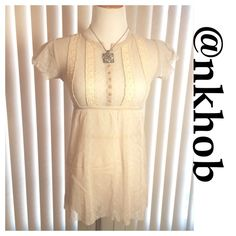 FREE PEOPLE Sheer Top Sheer top with button front short sleeve unfinished hem look!  Stitched detail front! EUC (A) Free People Tops