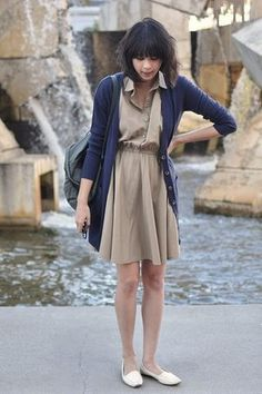 Tan dress, white loafers, navy blue cardigan