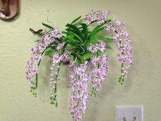 Clay orchid on wall