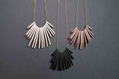 Small laser cut charcoal coloured beaded necklace