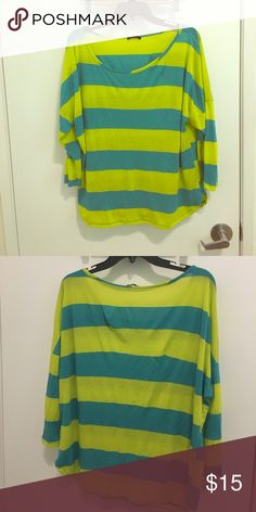 Enti stripped top Brighten up your day in this Slouchy day glow stripped shirt. No sized marked but fits like a large. Minor wear (pilling)  but other than that good condition. enti Tops Tees - Long Sleeve