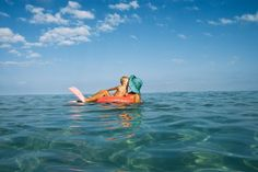 crisp blue water, cute colors, mom and son