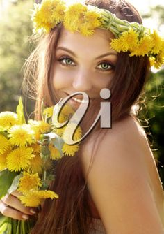 iPHOTOS.com - Photo of an attractive young summer girl with flowers