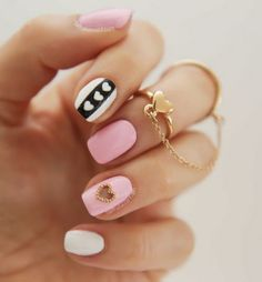 Pink nailart with white and heart accent