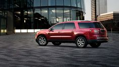 2015 GMC Acadia crossover vehicle in crystal red tint coat color.