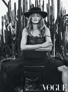 Cindy Crawford poses in Chanel dress with wide-brimmed hat