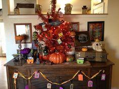 My Halloween tree. Made from the 1950's Christmas tree I spray painted orange.