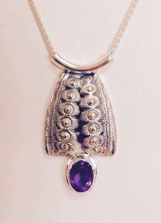 Pendant by Brenda Coleman. Sterling silver cast of a sea urchin, amethyst