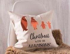 Get all the family involved with a stunning personalised family Christmas cushion, featuring each family member as a metallic brass effect penguin.