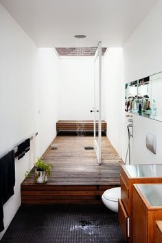skylight check. black mosaic tiles check. wood paneling check. wooden bench check. this might be my dream bathroom