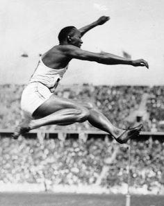 Jesse Owens takes gold in the long jump, Berlin 1936 (Wikimedia Commons/German Federal Archive) Rudy Steiner :') 1936 Olympics, Berlin Olympics, Summer Olympics, Jesse Owens, Tommie Smith, James Cleveland, Long Jump, Olympic Athletes, Sports Figures