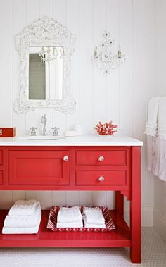 A painted bath vanity continues the home's casual, perky hues. More photos from this Michigan lake house: http://www.midwestliving.com/homes/featured-homes/house-tour-so-happy-together/?page=5